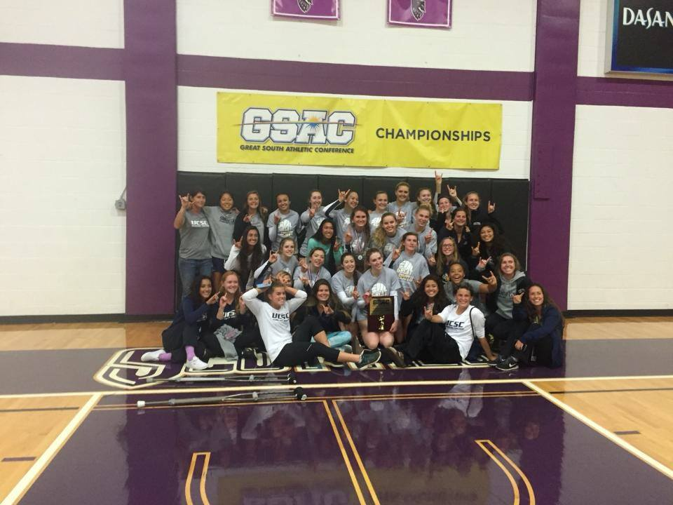 Women's volleyball and soccer teams celebrate GSAC championship titles.