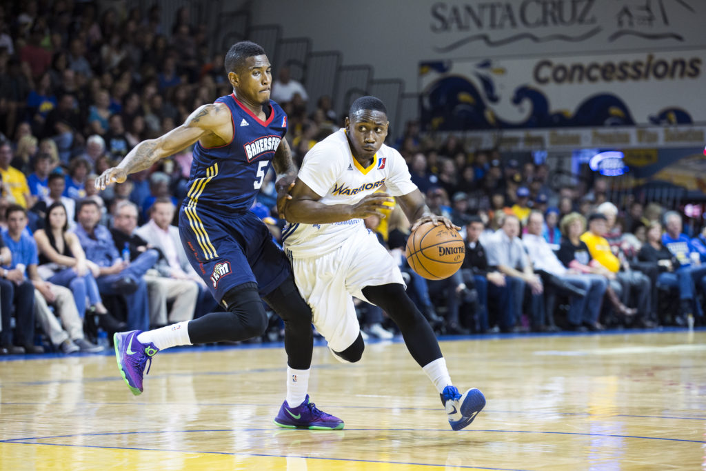 Juwan Staten of the Santa Cruz Warriors dribbles past Bakersfield Jam's Xavier Munford during their season opener last Friday night. Photo by Casey Amaral.