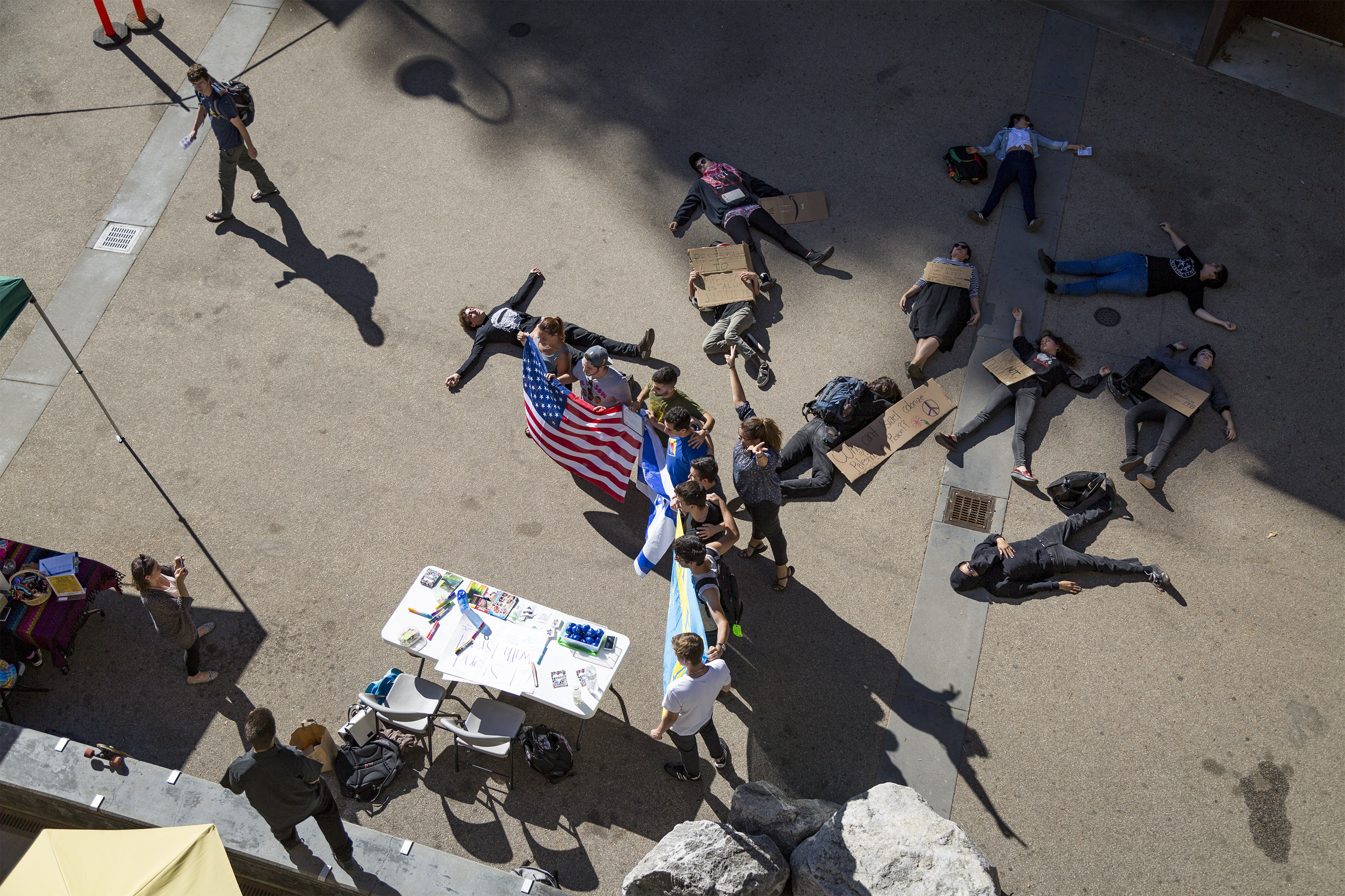 Students Hold a Die-In While Slugs for Israel Table