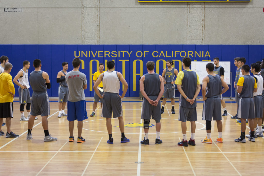 The men's team discusses strategy at practice on Nov. 6. Although the team lost to Westmont College the following day, players remain confident in the team's experience and ability. Photo by Jasper Lyons.