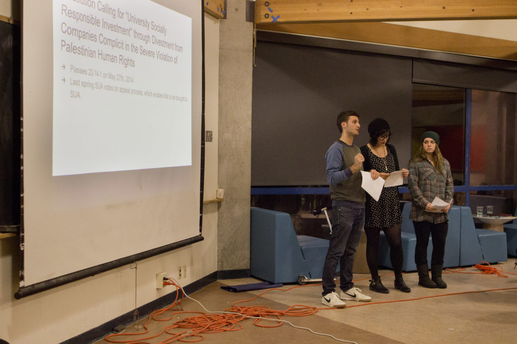 Students for Justice in Palestine members present their appeal during the SUA meeting on Nov. 10. Photo by Ali Enright.