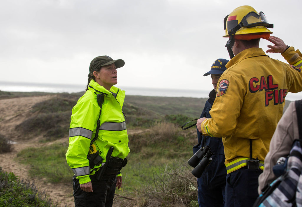 Authorities debrief after the active search was called off late Tuesday afternoon after 22 hours of looking for the missing students. Photo by Stephen de Ropp
