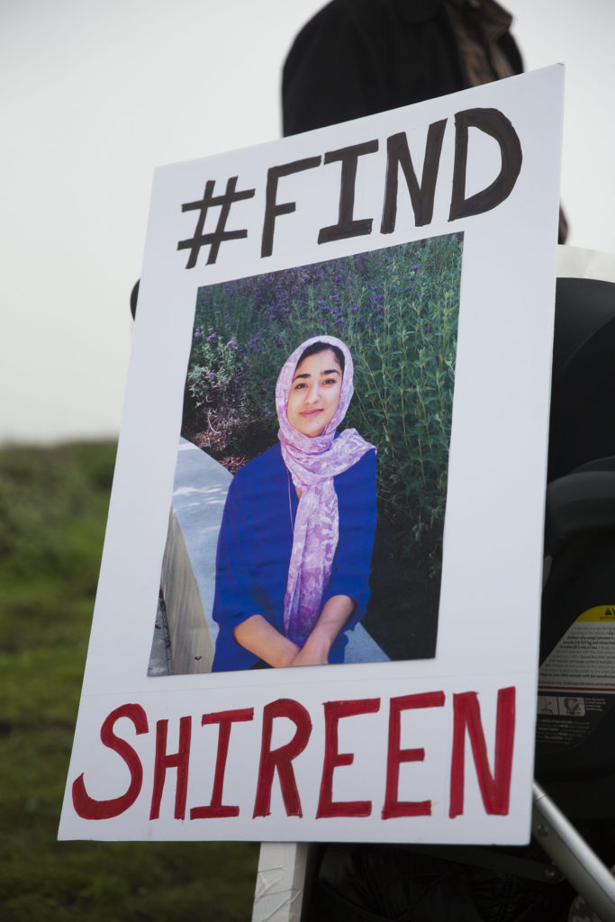 Friends and family members of Shireen Agha Ahsan brought signs to place around the Bonny Doon bluffs to show their commitment to continue the search for the missing students. Photo by Casey Amaral