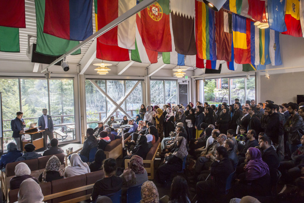 Over 100 friends, family and UCSC community members gathered in the College Nine Namaste Lounge in honor of Ahmad Solaiman Nourzaie and pray for him and the other student swept into sea at Bonny Doon Beach. Photo by Casey Amaral