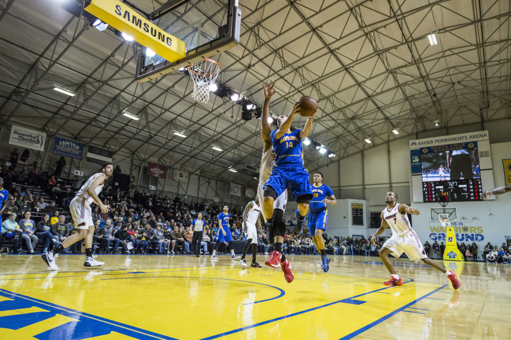 Point guard #14 Aaron Craft hangs in the air moments before laying up a basket. The Santa Cruz Warriors finished the D-league showcase 0-2, citing their loss of leading scorer Elliot Williams as a contributing factor. Photo by Jasper Lyons