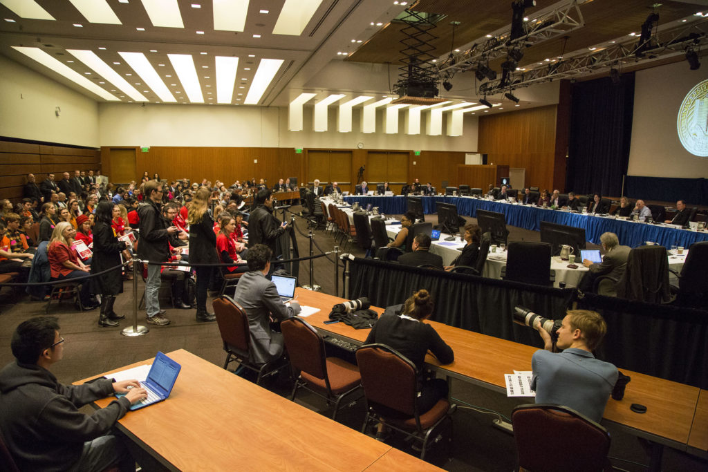 UC students speak during the public comment portion of the regents meeting. Photo by Jasper Lyons.