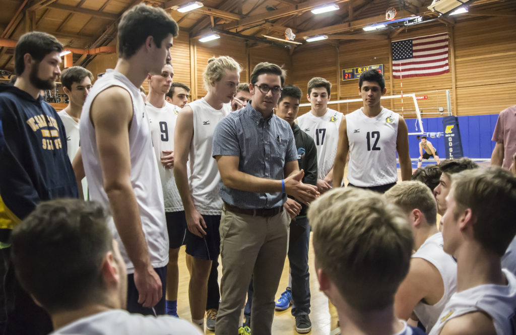 Paul Leon, the new interim head coach for the team, gives a pep talk to the players during its game against Benedictine University on Saturday night. Photo by Calyse Tobias