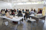 """Professor Laurie Palmer leads a critique during her """"Introduction to Sculpture and Public Art"""" class where students presented their clay sculptures made to represent a specific spot on campus. Photo by Casey Amaral"""