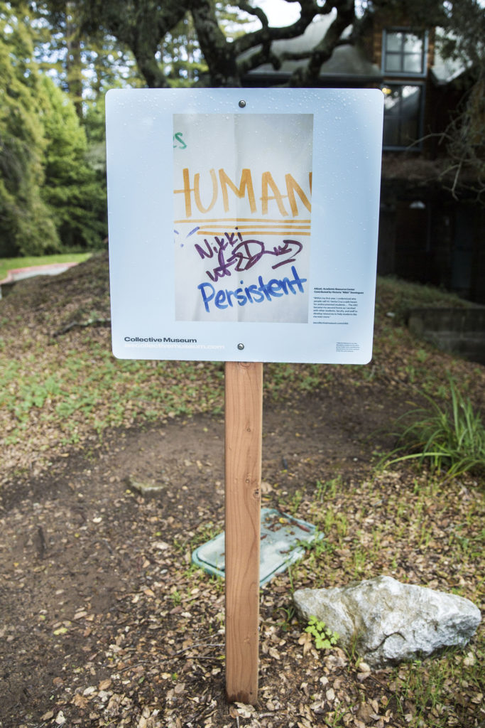 Blue signs have been popping up all around campus to create an art-inclusive museum experience around UCSC. Photo by Casey Amaral
