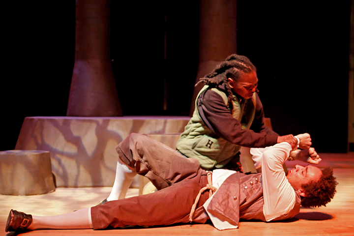 "Tyree L. Young and Ava Jenkins perform in Cultural Arts and Diversity's play ""Accept 'Except' LGBT NY."" The play is about the struggle for justice in America, from slavery to modern gay rights. Young stars as Sirus, a male from the plantation era, and Jenkins stars as Mike, a female from the penitentiary era. The two 20-year-olds are brought together after being chased by angry mobs in their respective time periods. The play's title refers to the ""exception"" of the 13th Amendment, that although people may not be privately enslaved, they can be publicly enslaved by the prison system. Photo by Calyse Tobias."