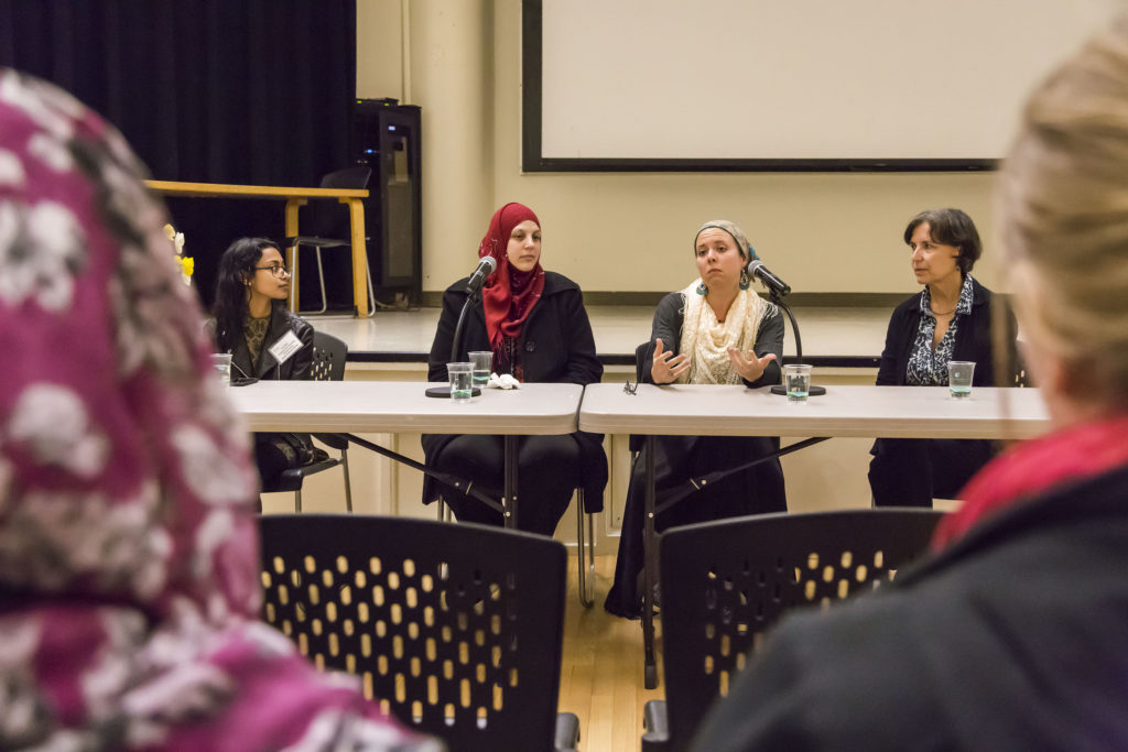 From left to right: UCSC inten Jacia Mim, film member Arwa Abushariefeh, film member Nur Laura Bean-Caskey and film director Dr. Rosemary Henze answer various questions about the Hijab's implications in the women's lives during the Q&A section of the event. Photo by Jasper Lyons.
