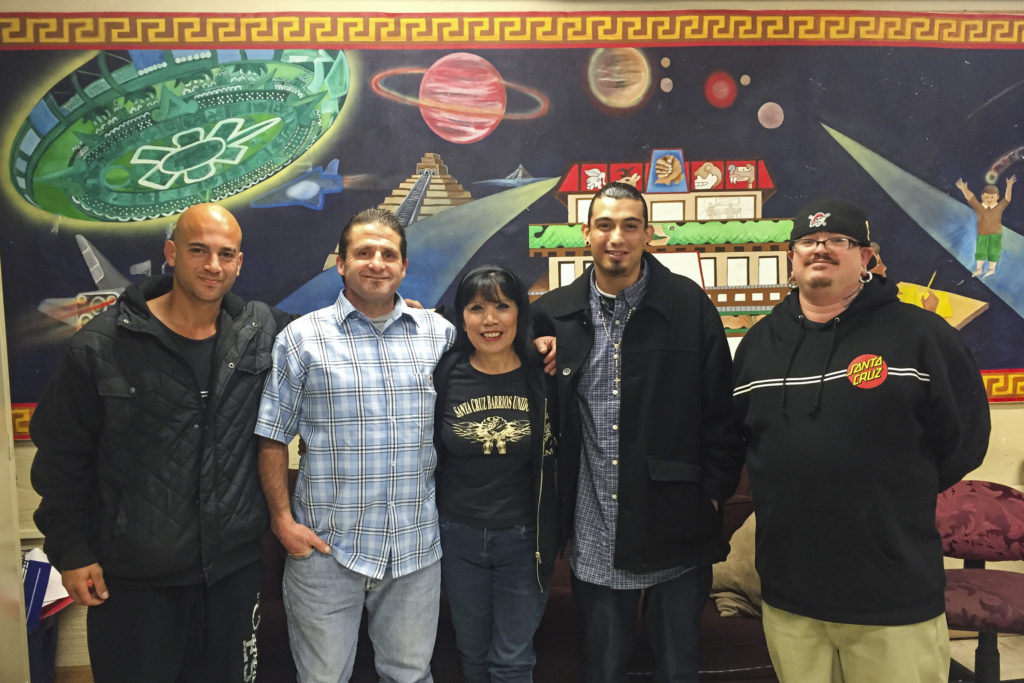 Mary Lou Alejandrez's program through Barrios Unidos helps former inmates reestablish their lives after prison. From left to right, Nick Koumides, Anthony Silva, Mary Lou Alejandrez, Alex Llanos and Joshua Stewart. Photo by Samantha Hamilton.