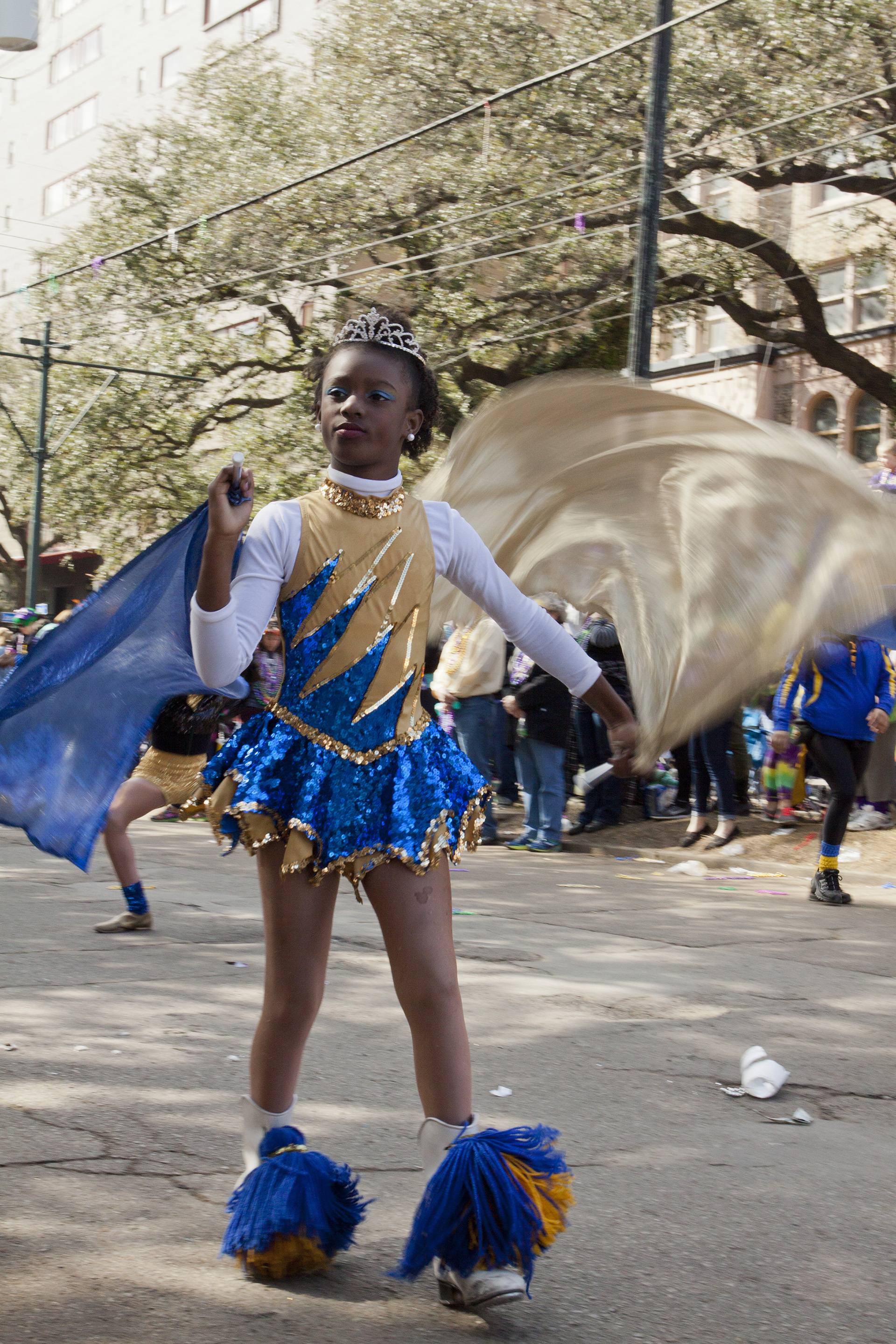 Marching bands, flag twirlers, and dancers from local schools joined the parades and set the rhythm for the procession.