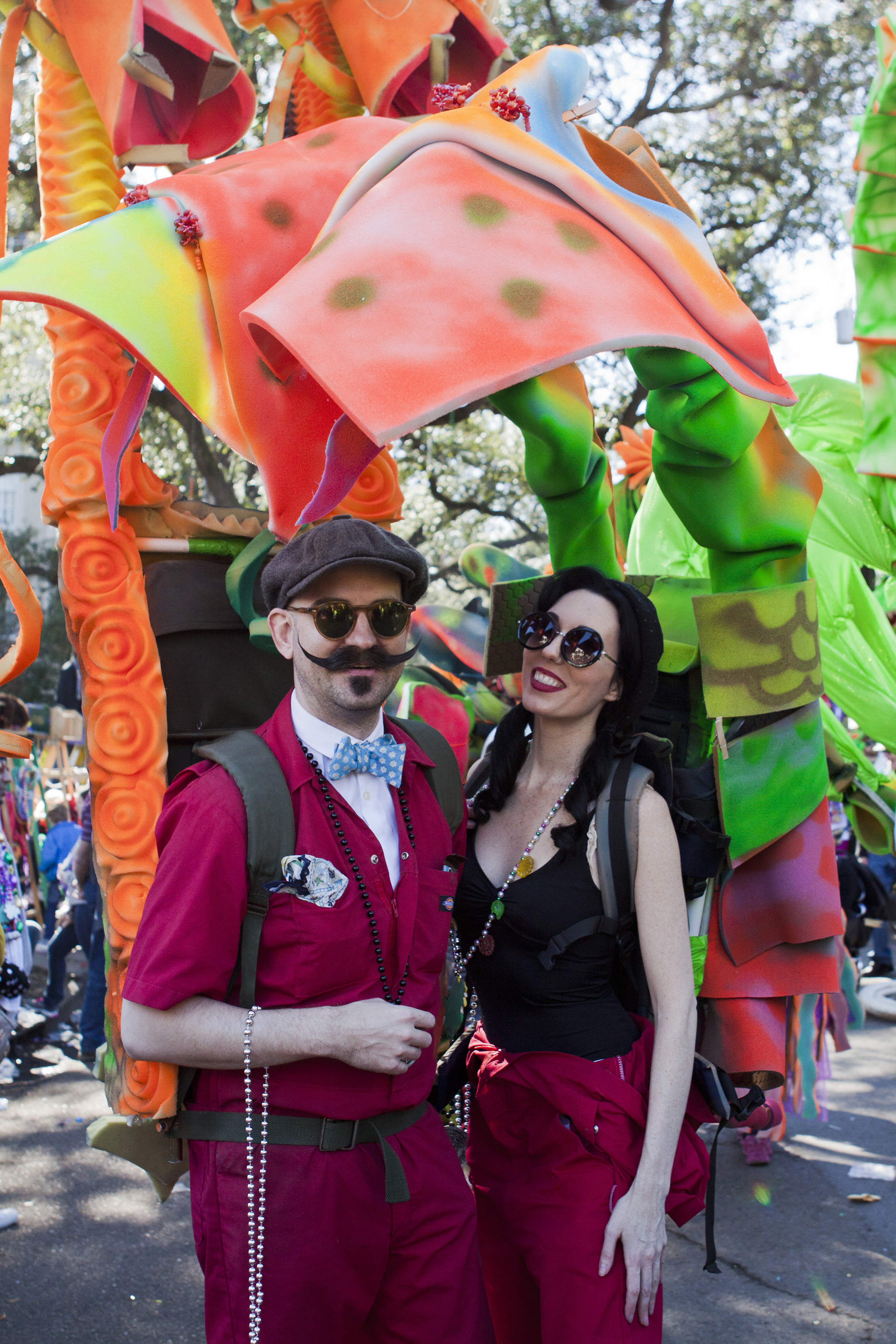 "Two members of the ""Dragons of New Orleans"" walking krewe displayed their homemade costumes during their participation in the Tucks Parade."