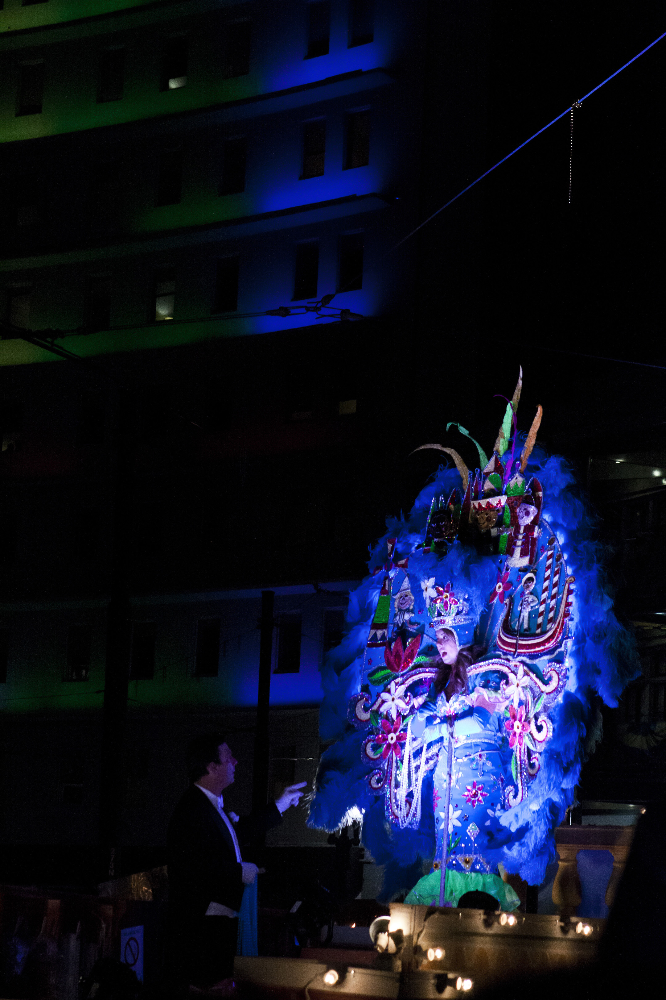 An Endymion maid participates in Saturday's nighttime festivities, with her costume decked out with extravagant jewels and lights.