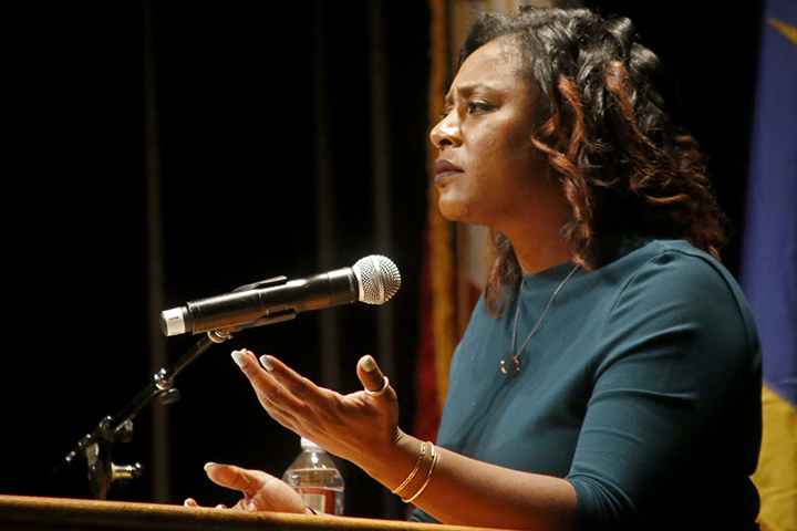 "Black Lives Matter co-founder Alicia Garza delievers her keynote address at to nearly 400 at the Santa Cruz Civic Center on Feb. 12. ""If this movement has shown us or taught us anything at all, it is that we cannot, must not, shall not be passive in the face of our oppressor,"" Garza said. Photo by Calyse Tobias"