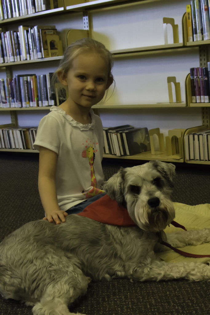 Lucy Binnert recently started attending Tales to Tails to practice reading and become more comfortable around dogs. According to her father John Binnert, she was extremely afraid of dogs and hesitant to touch them before this program.