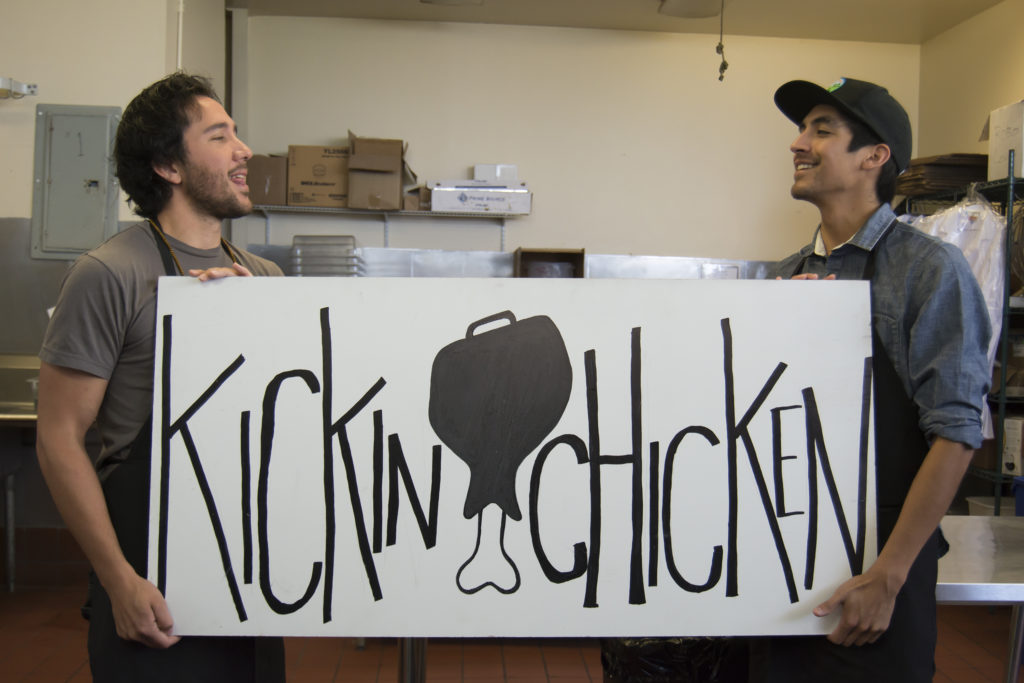 Justin Williams and Danny Mendoza created Kickin Chicken, a late-night delivery service for chicken and waffles and other southern-style food. Justin creates the logos and art for the business. Photo by Megan Schnabel
