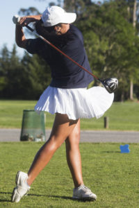 Ravipa Losakul practices her swing at the driving range. Photo by Calyse Tobias.