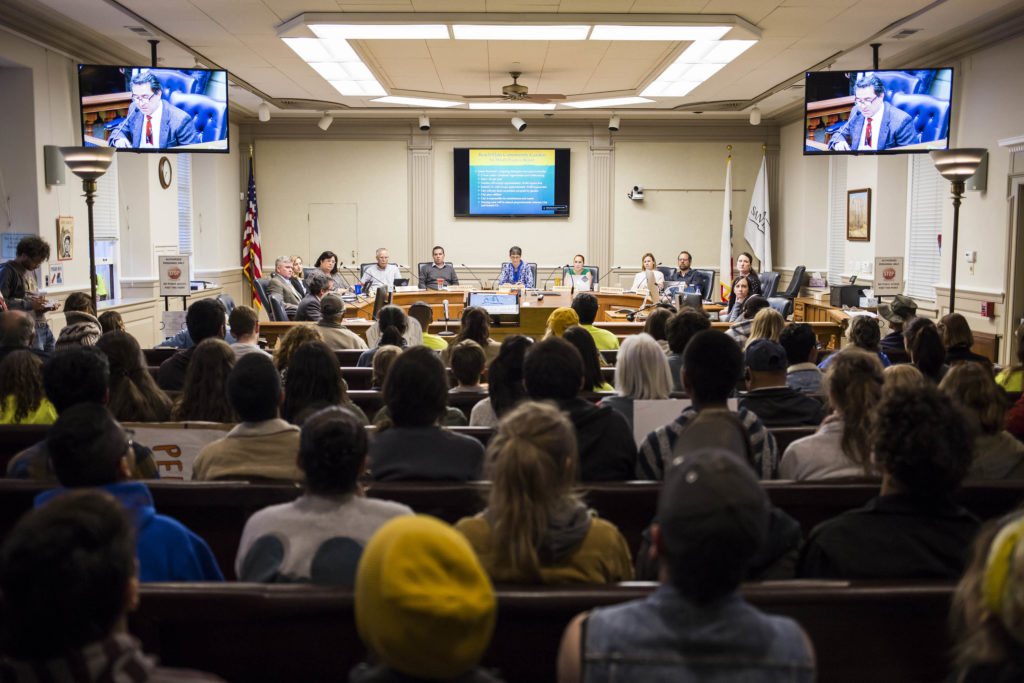 The Santa Cruz City Council sits before an audience of Beach Flats Garden supporters to address updates in regards to the future of the space. Santa Cruz Director of Parks and Recreation Mauro Garcia (on screen) reviews the signed lease agreement. Photo by Jasper Lyons