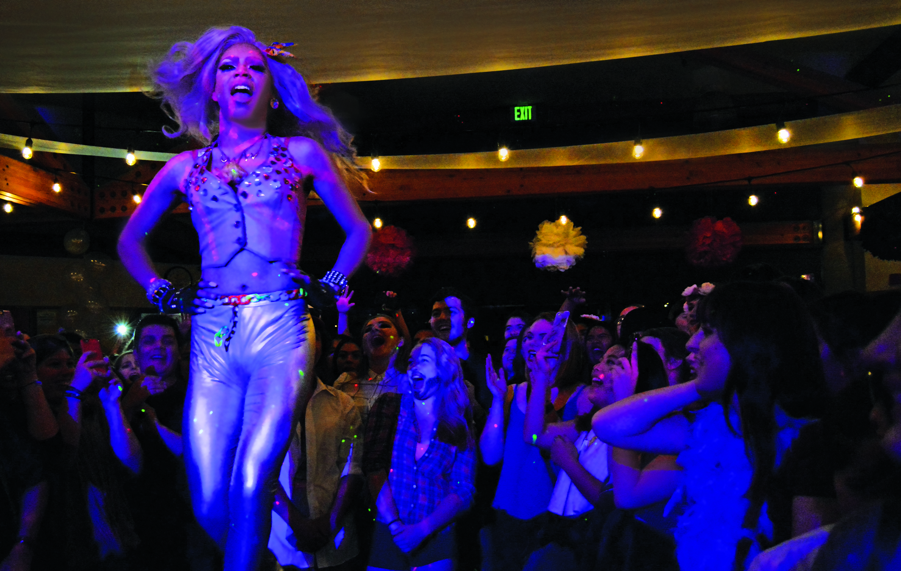 "Girl Trouble, a group of professional drag performers, dance and lip-sync to music while taking the runway. Karla Dream performs to Kesha's ""Blow"" at the Oakes Learning Center. Photo by Megan Schnabel"