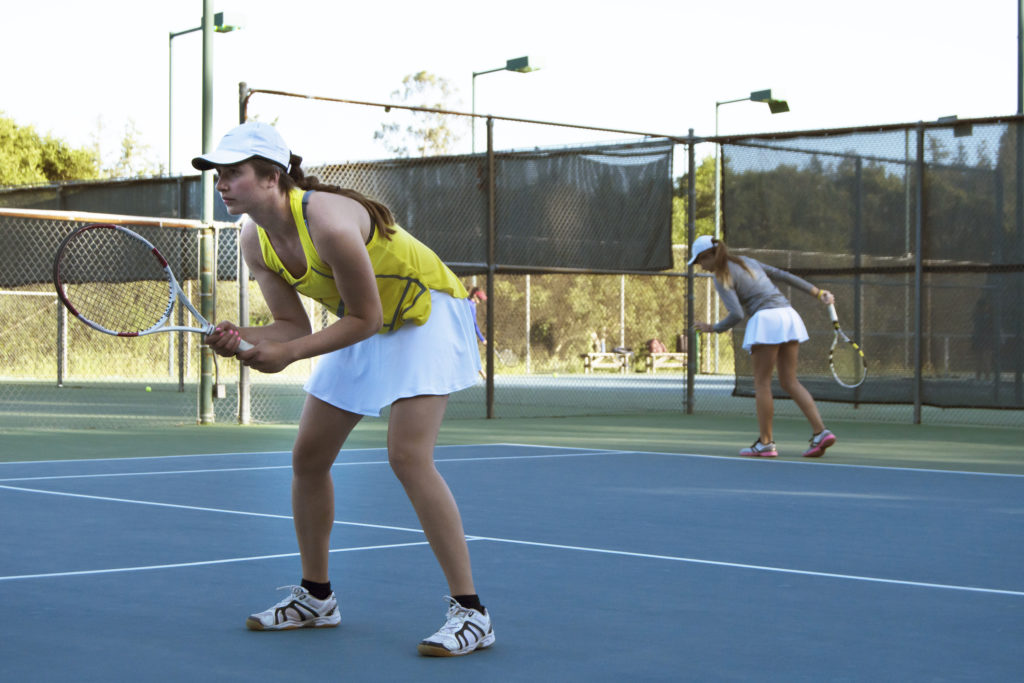 Last Monday, Eva Buciek and Zoe Brook played doubles during a scrimmage in preparation for the upcoming championships. Photo by Megan Schnabel