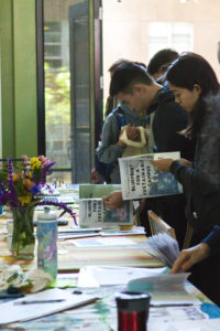 Students and community members pick up resources, such as information on the Blueprint for a Sustainable Campus, at tabling sessions for those interested in environmental justice. Photo by Ali Enright