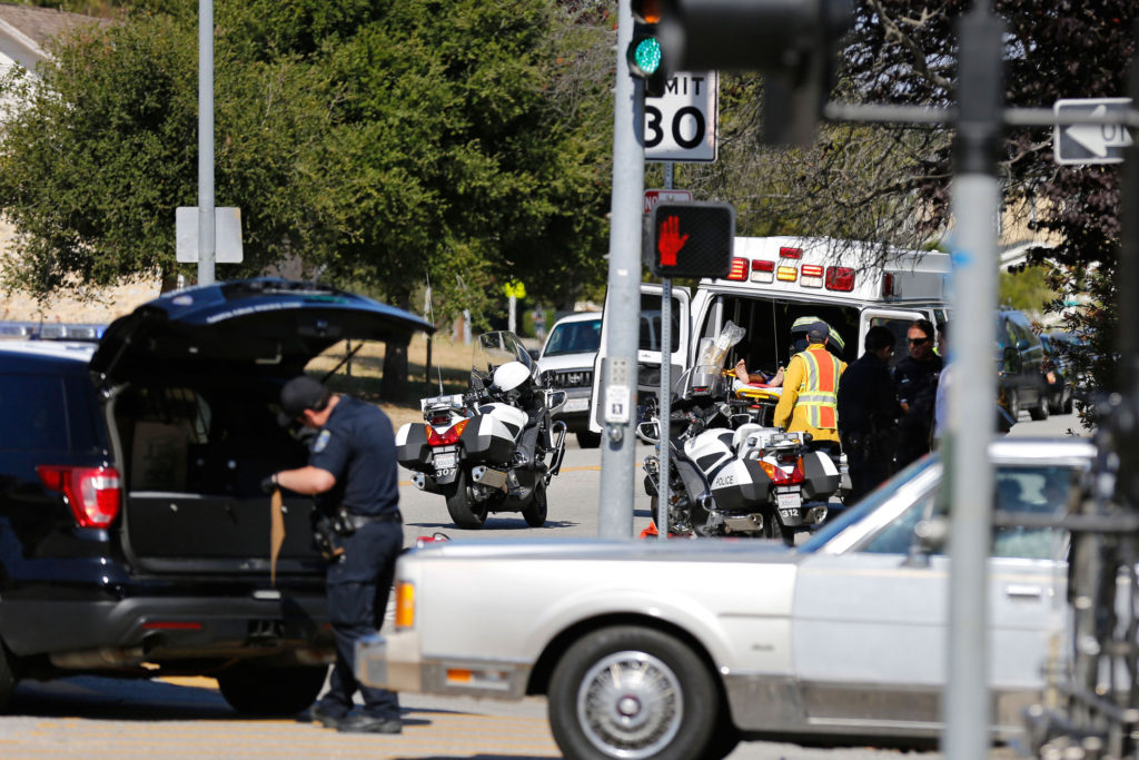Emergency personnel tend to the victim of a hit-and-run at the intersection of Bay and High Streets on June 5.  Photo by Stephen de Ropp.