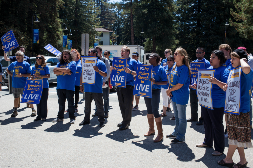 Protesters gather in the Quarry Plaza demanding secure pension and increased salary. Photo by Calyse Tobias.