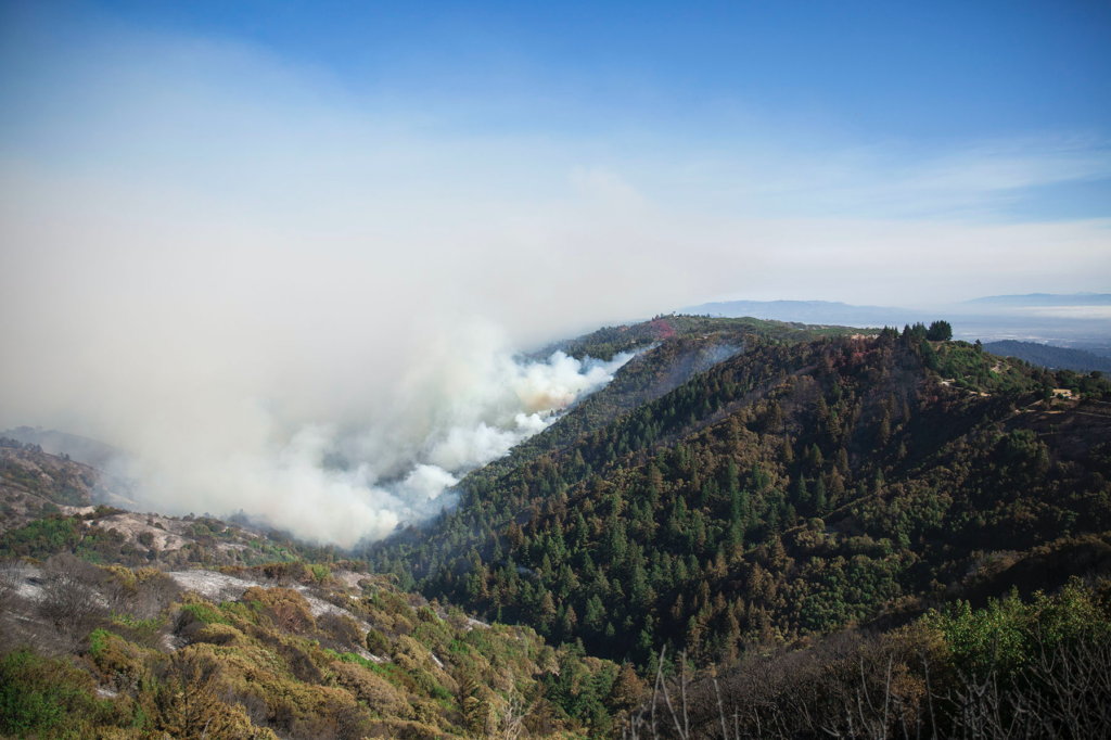 Smoke billows from the Loma Fire, which continues to blaze within Santa Clara County lines. Photo by Casey Amaral.