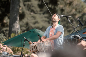 Tarun Nayar, who plays electronics and tabla for Delhi 2 Dublin (also known as D2D), performs on stage at the 2016 Hardly Strictly Bluegrass festival. Photo by Ian Wu