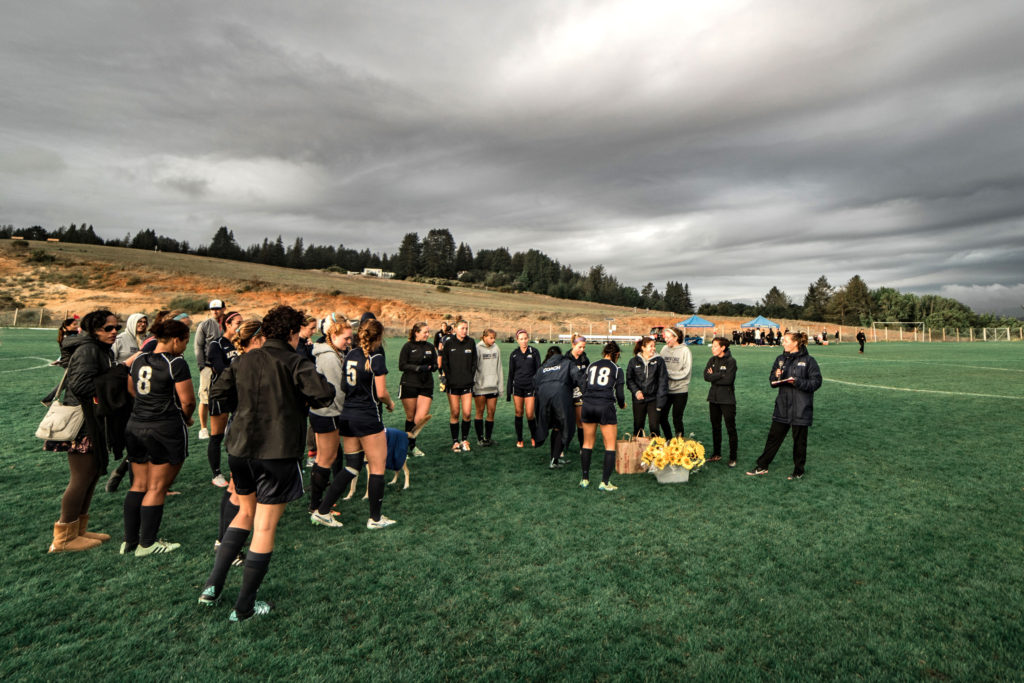 The Slugs gather after their game and coach Emily Scheese gave out flowers to the seniors and shared favorite moments with teammates and family members. Photo by Yin Wu