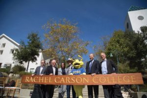 Claudia and Alec Webster (center) join Chancellor George Blumenthal and others for the unveiling of the new Rachel Carson College sign. Photo by Matthew Forman.