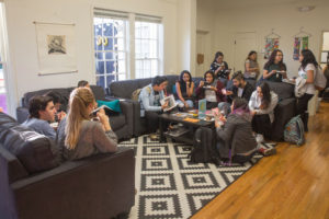 Dozens gathered in the Cardiff House to be a part of the celebration. The event kicked off outside where the speakers expressed the importance of having safe places for women. After the speeches the attendees socialized and shared cake in the newly-renovated house. Photo by Casey Amaral
