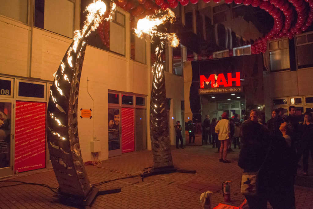 A 12 foot tall stainless steel sculpture greeted the attendees as they made their way outside. This piece created by the Flaming Lotus Girls, a group of artists known for their large-scale metal installations, allowed people to control the flames that projected from the sculpture by the push of a button.