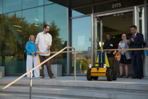 A robot does the honor of cutting the ribbon at the new UC Santa Cruz Silicon Valley Extension building opening ceremony. Photo by Matthew Foreman