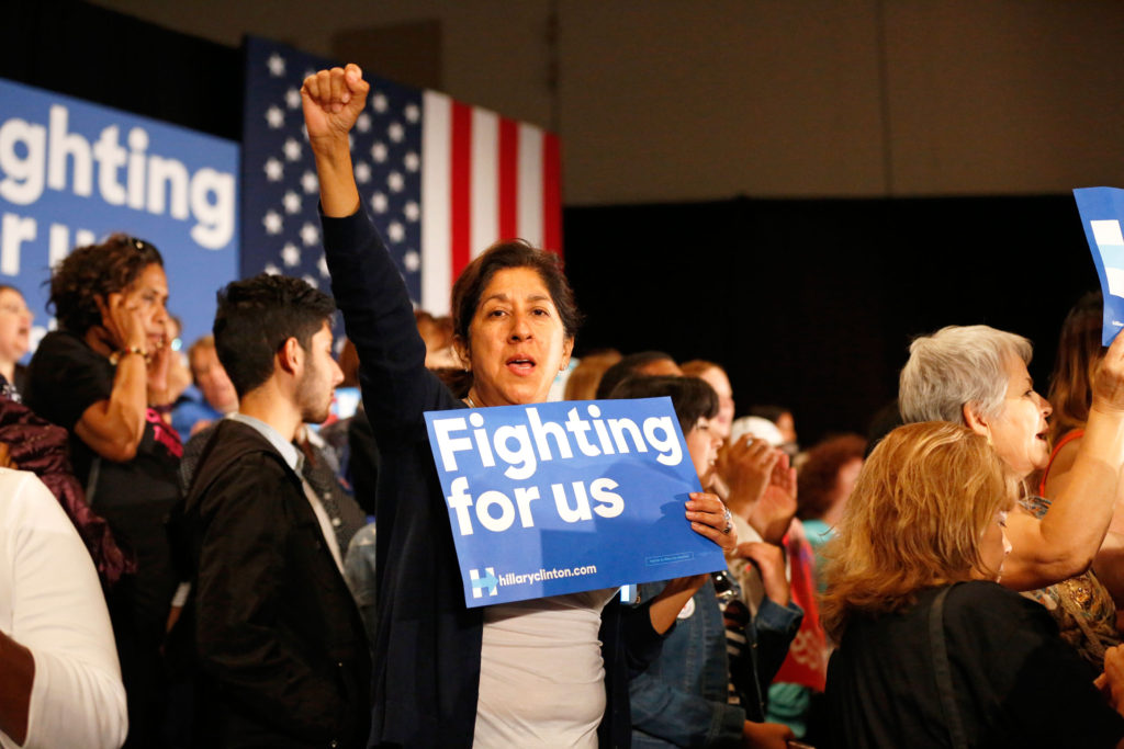 A Hillary Clinton supporter reacts as former Secretary of State Clinton enters the room for a speech in San Jose on May 26. Photo by Stephen de Ropp.