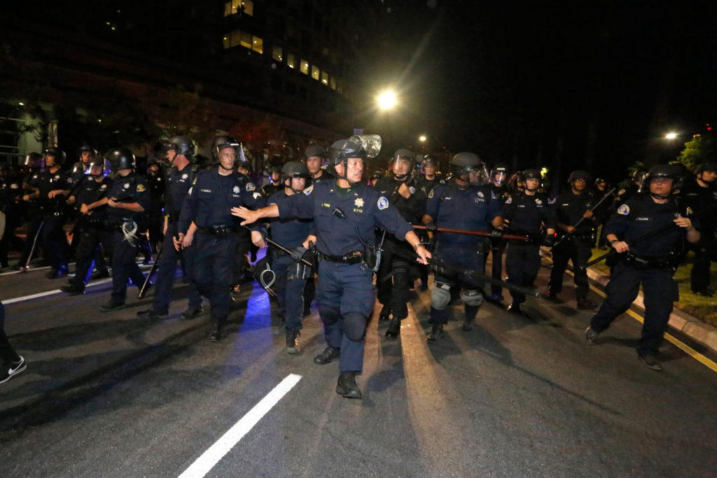 "San Jose Police Lt. Johnson Fong commands a force of riot police as they ""kettle"" protesters, pushing them away from the downtown area and through the streets of San Jose. Photo by Stephen de Ropp."