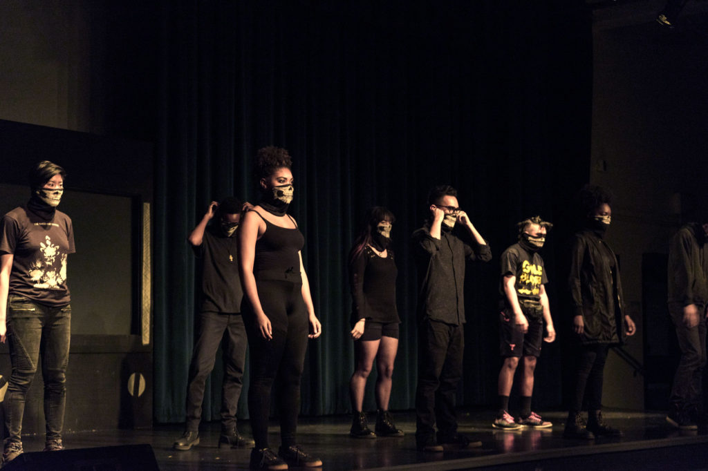 The production began with masked cast members performing narrative expositions. Each piece addressed the use of force by police and the anger and exhaustion felt by those affected. Photo by Yin Wu