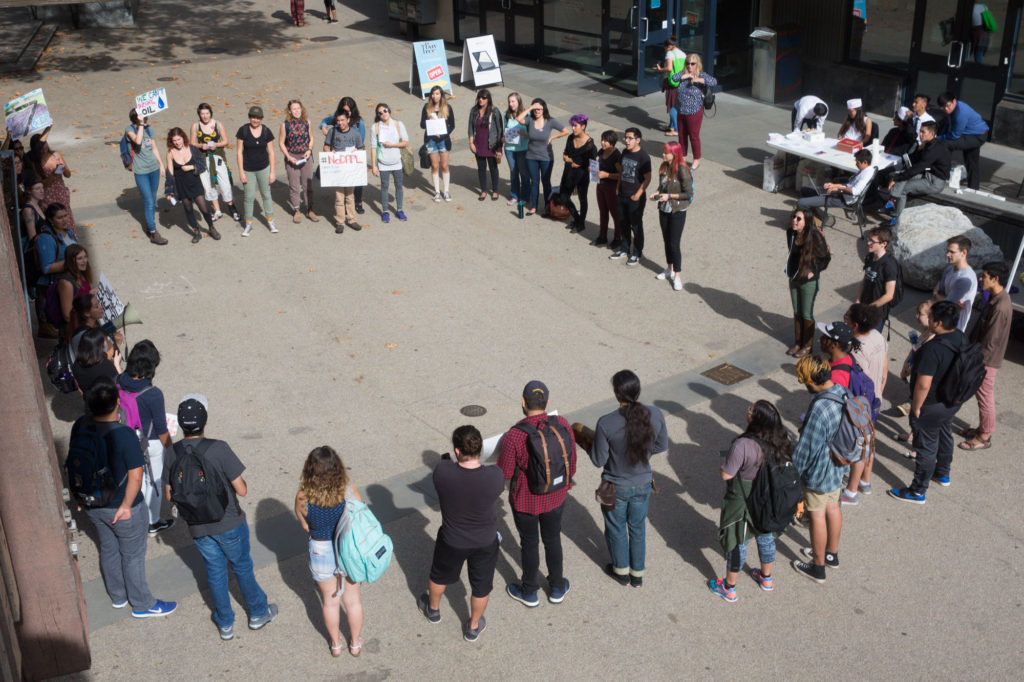Dozens of students, including several undocumented attendees and members of the Student Alliance of North American Indians, gathered in Quarry Plaza on Monday to show support for everyone protesting on the front lines and to stand in solidarity with the native tribes affected by the redirection of the North Dakota Access Pipeline. Photo by Casey Amaral