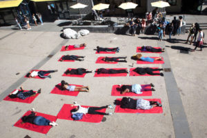 In Quarry Plaza on Nov. 4., members of the African/Black Student Alliance (A/BSA) laid in chalk outlined bodies representing the underreported victimized people of color targeted by police. Photo by Calyse Tobias
