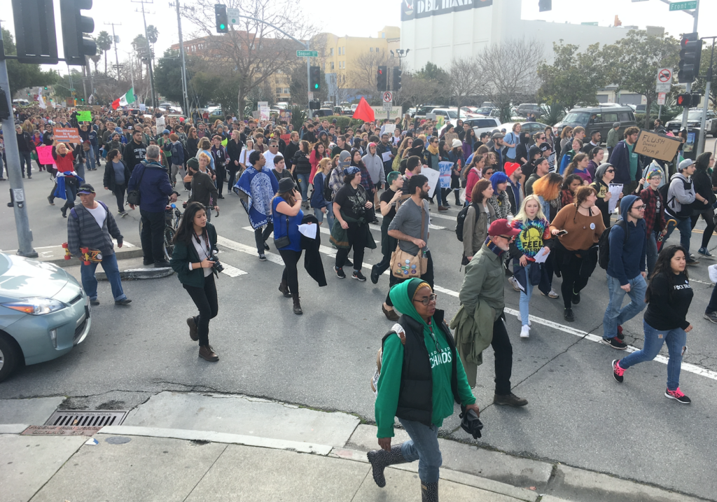 Nearly 500 students, staff and community members marched downtown midday today in protest of Donald Trumps' presidential inauguration. Photo by City on a Hill Press staff.