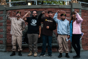 Local Brown Berets join the Watsonville community event. The civil rights group attended to ensure a sense of safety for attendees and to support the right of undocumented people. Photo by Alonso Hernandez.
