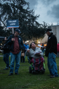 A handful of attendees carried anti-Trump signs in protest of the new president. Photo by Alonso Hernandez.