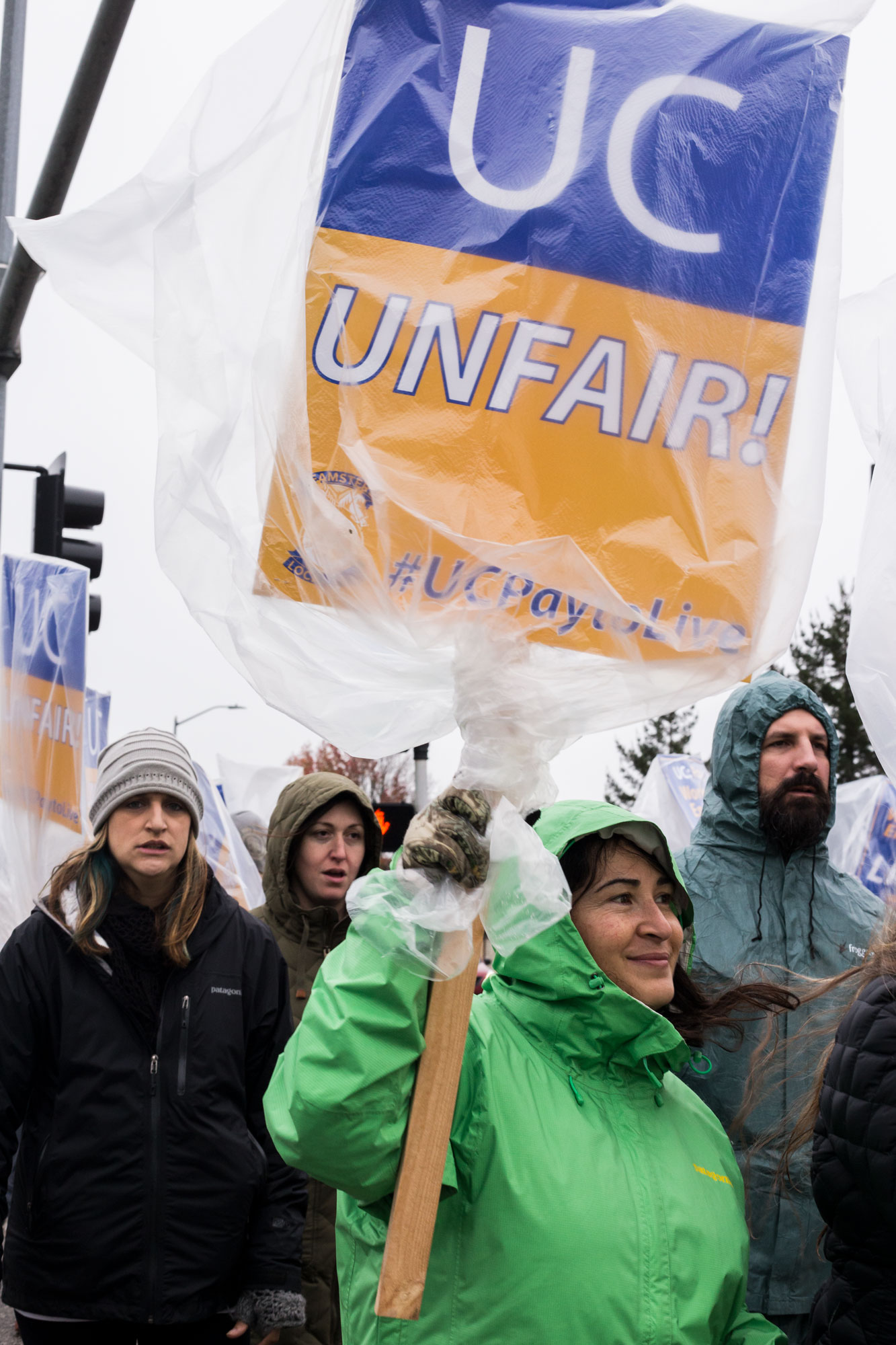 Nancy Szemeredi, center, marched with other Teamsters Local 2010 union members on Tuesday during their strike at the east entrance to campus. Photo by Calyse Tobias