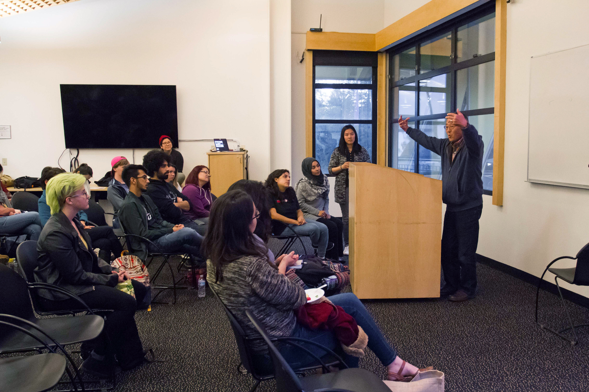 """Two representatives, one on behalf of the Muslim Students Association and the other from the Asian and Pacific Islander Student Alliance, spoke at the """"From Internment to the Muslim Ban: Mobilizing in Solidarity"""" hosted in the Cervantes and Velasquez Conference Room. Photo by Sean MacNaughton"""