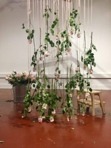 """hung their roses, they became part of the art piece. """"After you measure out your body with the yarn and hang this rose that you pick from the bouquet, the rose then becomes a part of you,"""" said Escobedo. After a while, the art began to deteriorate, dropping leaves, petals and even some entire flowers."""