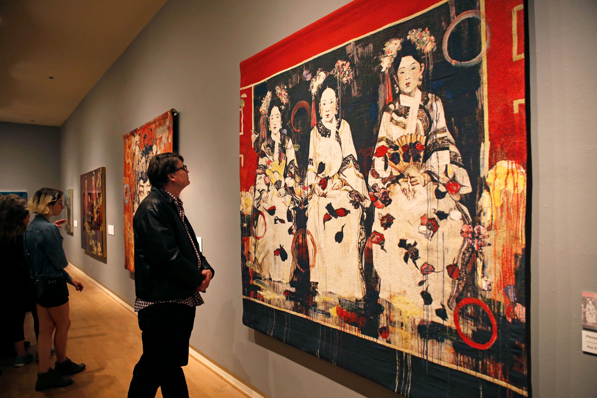 """Three Fujin of a Prince"" is just one of the several jacquard tapestries created by Hung Liu. The pattern in these tapestries are woven together to create intricate and vibrant images without the use of printed textile. Photo by Casey Amaral"
