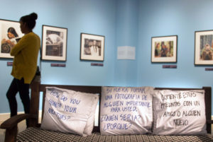 "Found in the ""Photographs of Different California Indian Tribes"" gallery, a couch with three pillows invited MAH visitors to sit down and interact with each other. From left to right, the messages read ""How Do You Honor Your Ancestors?"" ""If you could take a photograph of someone important, who would it be and why?"" and ""Comment on these questions with a friend or someone new."" Photo by Danielle Del Rosario"