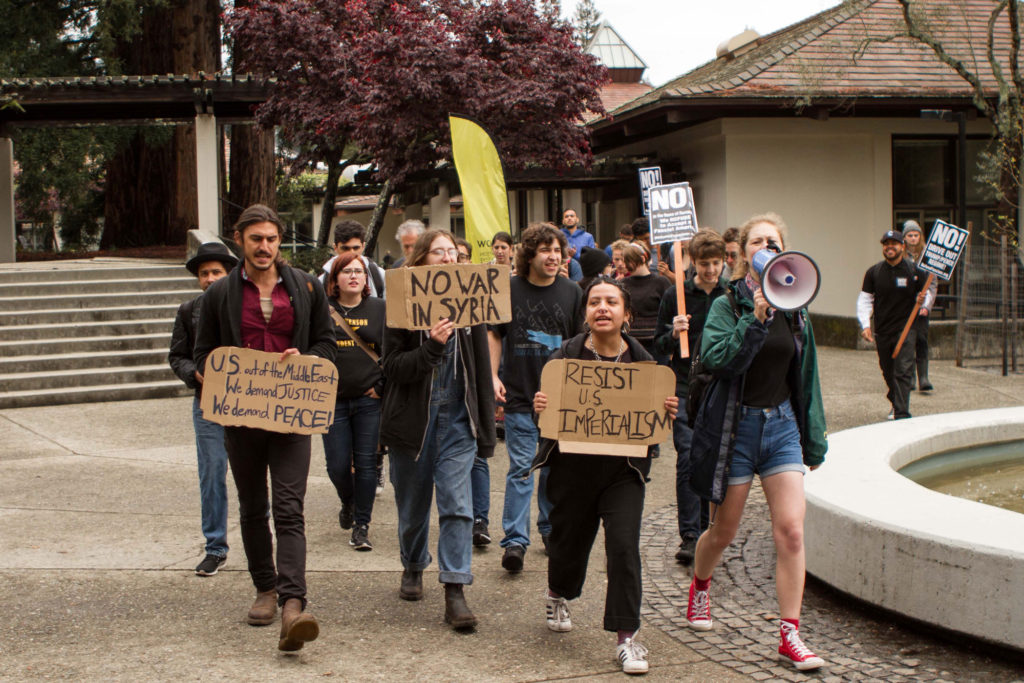 Students march through Cowell College on April 12 to protest the possibility of a war in Syria. Sean MacNaughton